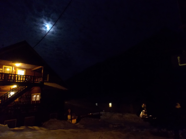 "Lodge #6 glows as the moon begins to poke through the clouds.<a href=""/reason/images/595326_orig.jpg"" title=""High res"">∝</a>"