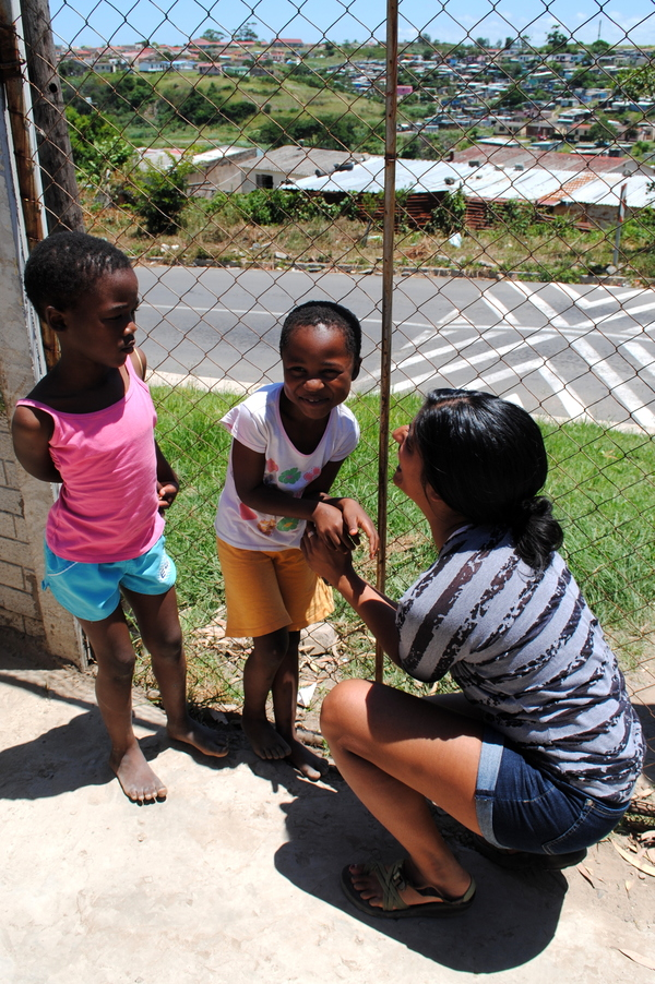 "Ami Gilbert plays with two young girls at the Ubuntu Rescue a Child at Risk Center.<a href=""/reason/images/526331_orig.jpg"" title=""High res"">&prop;</a>"