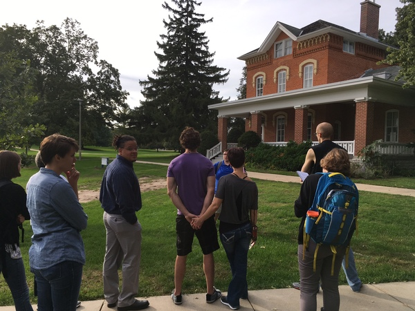 Participants of the Walk for Peace gather around the campus house and learn about the struggle of diverse people on campus and how Luther College has become more accepting and reflective of changing and developing diversity.
