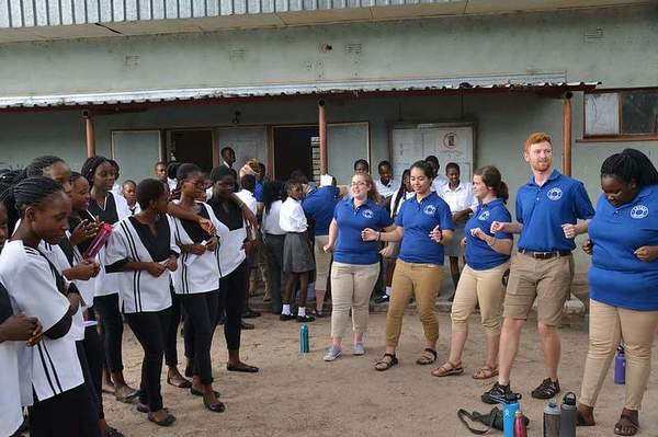 Learning a song and dance from the highschoolers at Oshigambo High School.