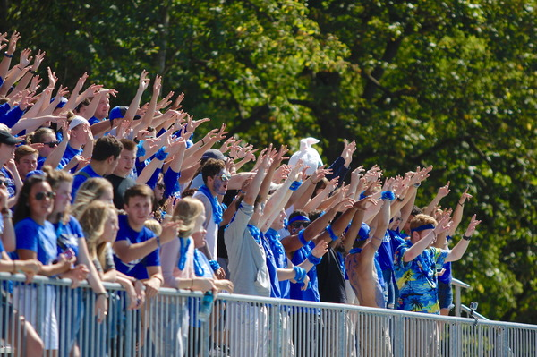 Luther students cheer in the Carlson Stadium stands.