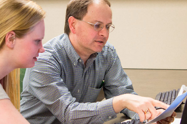 Psychology student Lexi Scharmer conducts research with Professor of Psychology David Njus.