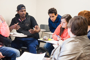 Students having a discussion in the African-American History course, which is a survey of African-American history from the 15th century to the present. Eras and topics include the trans-Atlantic slave trade, slavery in the Americas, the Civil War and Emancipation, segregation, the Great Migration, the Great Depression and World War II, the modern black freedom struggle, and the post-civil rights era.