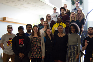 Acclaimed film director Charles Burnett posing for a group picture with students in the African American Influence on Popular Culture course.