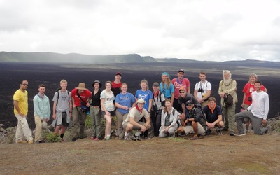 The complete J-term crew perched on a cliff in front of the Sierra Negra volcano caldera. A clear day such as this, where one is able to see all the way across the caldera, is practically unheard of.