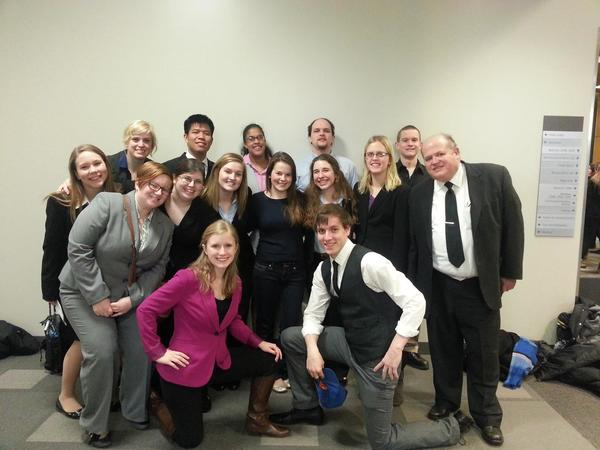 Students in the Mock Trial Team posing for a group picture with Political Science professor Michael Engelhardt.