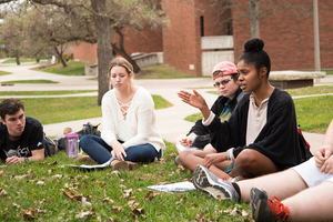 Students partaking in a discussion outside for the the Criminal Justice in the United States course.