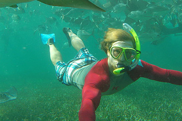 A student goes snorkeling in Belize during J-term 2016.