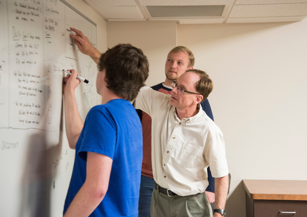 Students and faculty participate in small-group summer research projects.