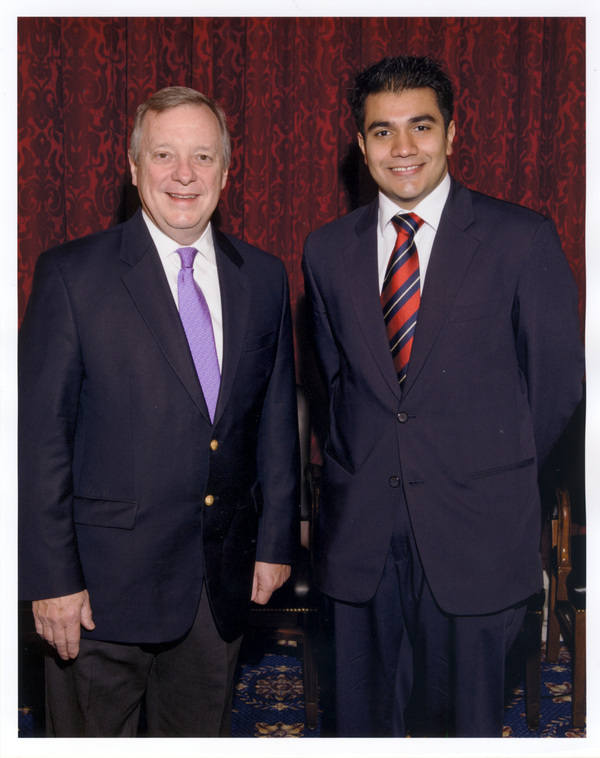 Luther student Kazi Ahmed (at right) with Senator Richard Durbin.
