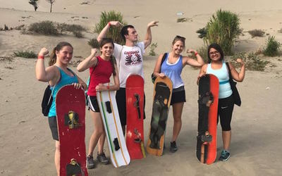 Trying another exciting adventure: Sandboarding!