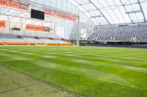 Here is the close up of the pitch and stands. The grass here is the only pitch grown in the World under a fully enclosed roof. The grass is also woven with artificial turf to give the pitch some strength. You can see the divide of the two within the picture. And the roof provides water for the pitch. Great technology at work here.