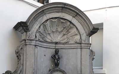 This is Manneken Pis! The 2 foot tall little boy is of the top tourist sights to see in Brussels.
