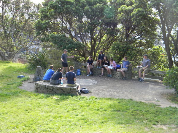 "Students participating in a discussion at the base of Mount Victoria.<a href=""/reason/images/521415_orig.jpg"" title=""High res"">&prop;</a>"