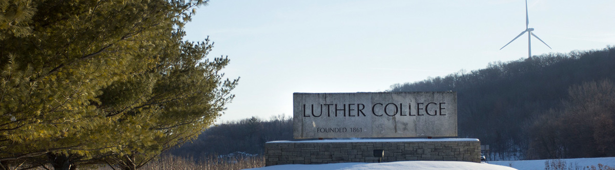 View of the Luther College sign and wind turbine.