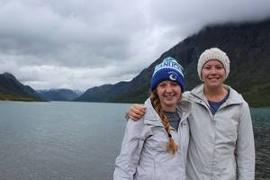 Students pose near a fjord in Norway