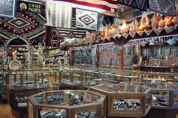 "This is only half of the showroom inside at Perry Null Trading Company, featuring countless pieces of jewelry, pottery, fetishes, baskets, and rugs that caught the whole crew up for a few hours.<a href=""/reason/images/602432_orig.jpg"" title=""High res"">∝</a>"