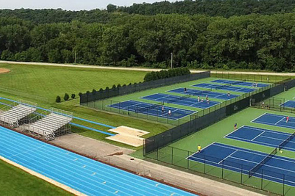 A wide shot from above of the Luther tennis courts.