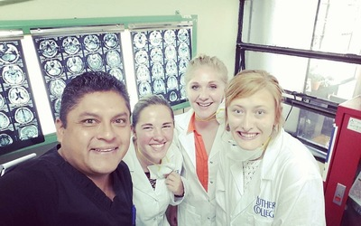 Making new friends during our adventures in the hospital. Pictured: Kjerstin Nelson, Bailey Pohlman and Annie Holtz with our Doctor, Carlos Azabache, who was helping us to understand what was going on in the surgery wing of the hospital.