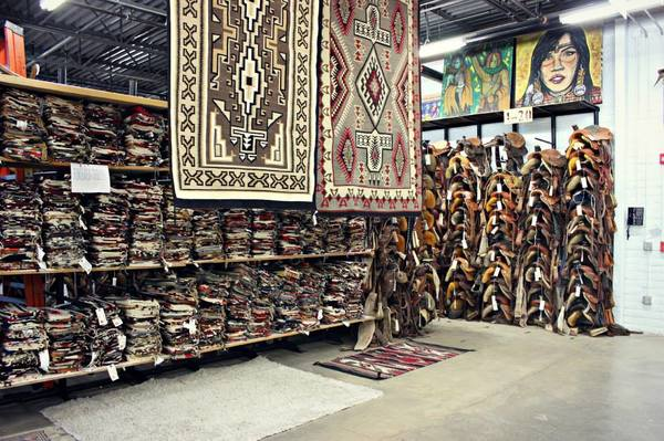 "Some of the shelves displaying thousands of rugs in the vault, and Perry's two favorites that he received as gifts hanging from the rafters.<a href=""/reason/images/602444_orig.jpg"" title=""High res"">∝</a>"