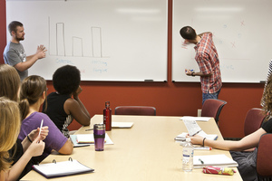 Luther students work on a group project for a psychology class.