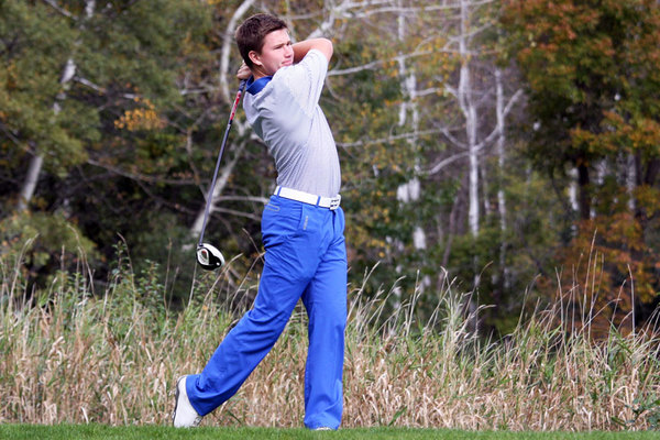A Luther golfer hits a drive into the distance.