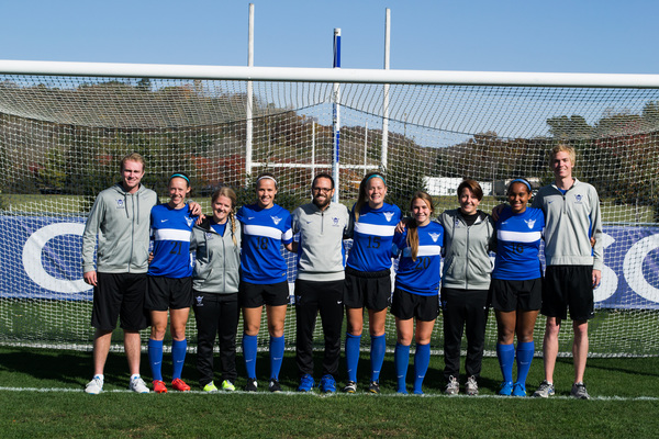 Luther College soccer coach with some of the soccer team members.