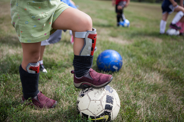 A child attending one of the soccer summer sports camps at Luther College.