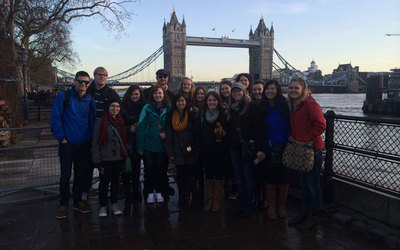 The group poses in front of Tower Bridge, right before entering the Tower of London!