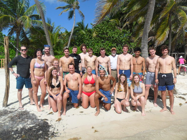 "The group poses on the beach of the Ak'bol Yoga Resort.<a href=""/reason/images/742461_orig.jpg"" title=""High res"">∝</a>"