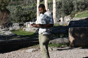 Luther student Obi Ukabiala reading a selection from Homer's Odyssey at the ancient site of Delphi, home to ancient Greece's most famous oracle.