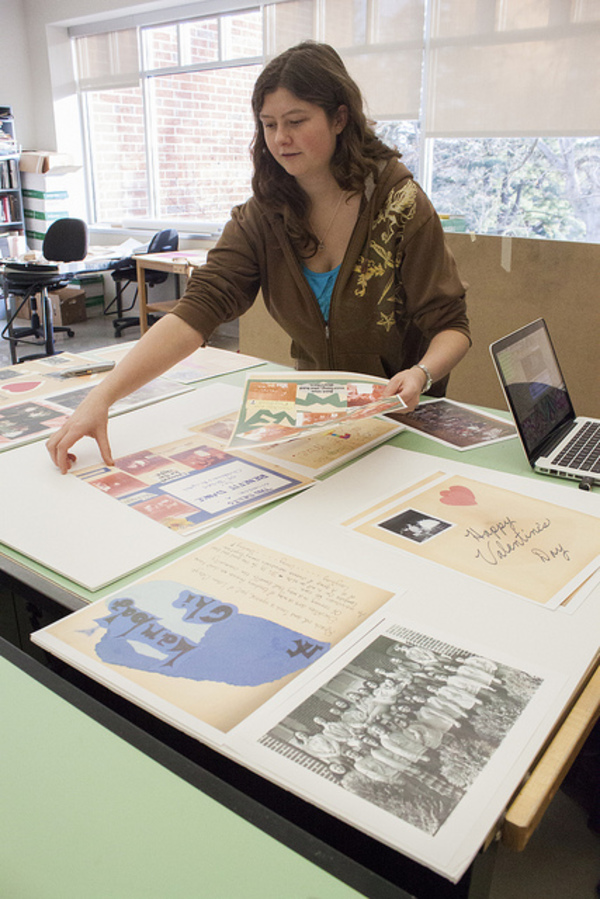 Velvet Warne prepares layout for exhibit planned for Preus Library.