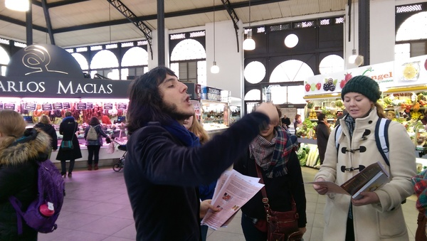 A customary photo of Carlos charismatically explaining something - this time it happened to be in the Market of Salamanca.