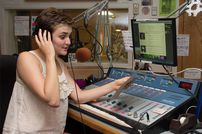 Student operating the radio booth in KWLC.