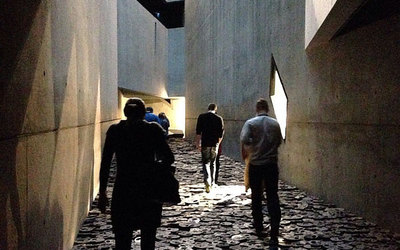Some of our students walking through the Void of Memory at the Jewish Museum of Berlin.
