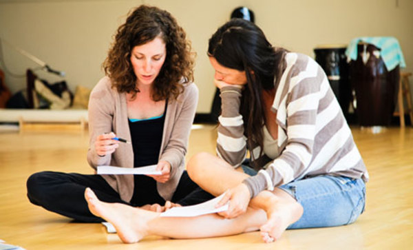 Jane Hawley assists a dance student.