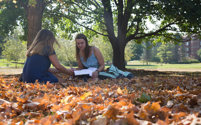 Liberal arts college students studying outside.