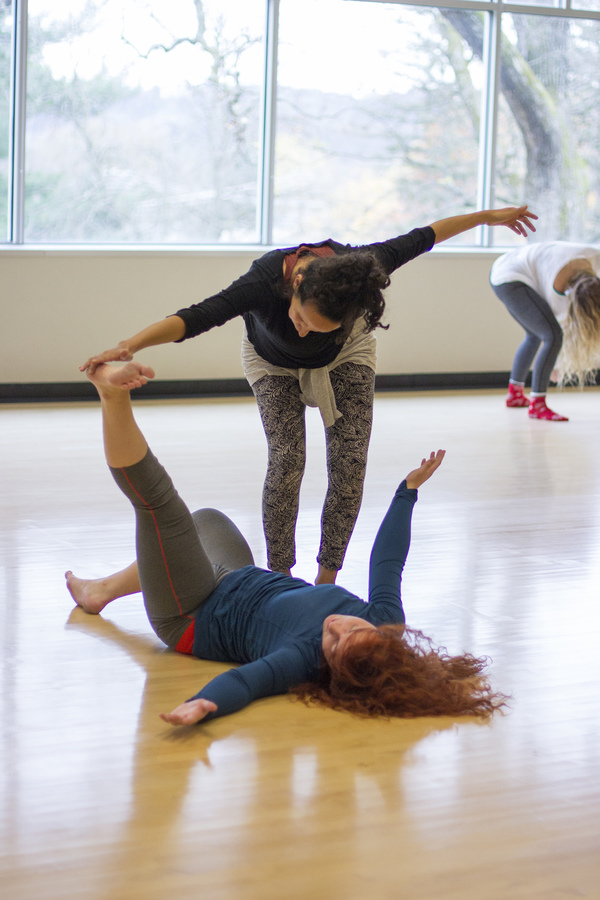 A student dances with a professor in a Movement Fundamentals class