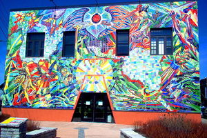 The vibrant exterior of the Resource Center of the Americas in Minneapolis, Minnesota.