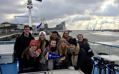 The group on the boat ride trying to enjoy some fresh air, also trying not to freeze!