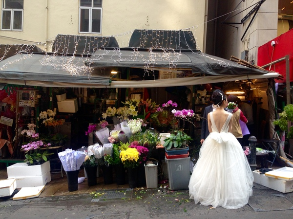 "A bride in front of a flower shop<a href=""/reason/images/600535_orig.jpg"" title=""High res"">∝</a>"