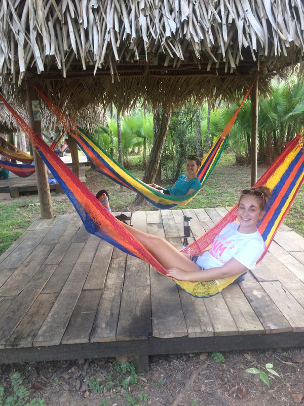 "Students Rachel Schunder (front) and Hanna Christopher (back) relax in hammocks after a long travel day.<a href=""/reason/images/797535_orig.jpg"" title=""High res"">∝</a>"
