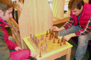 Students playing chess in the Physics Library and Exploration Center.