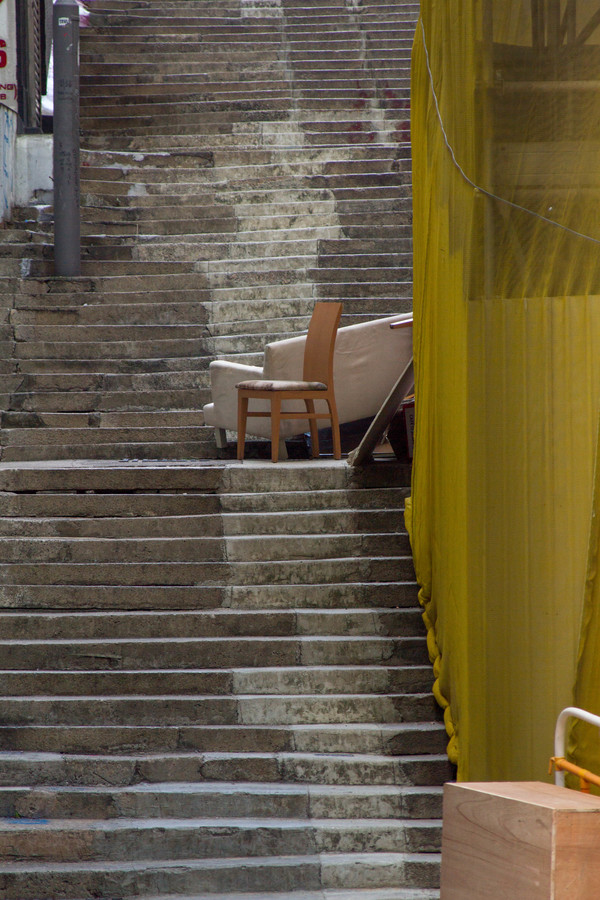 "An empty staircase with a sofa and chair in the middle of it in Central Hong Kong.<a href=""/reason/images/600541_orig.jpg"" title=""High res"">∝</a>"