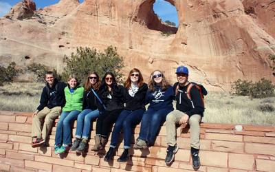 The New Mexico Squad in front of Window Rock, the geological landmark for which the location of the government of the Navajo Nation is named after.