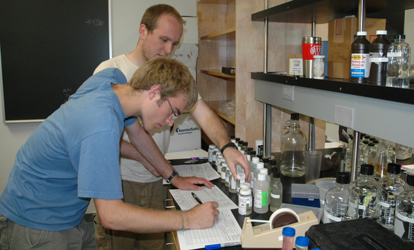 "Luther Biology students Jacob Wittman and Andrew Weckwerth record data from analysis of samples taken from waterways in Dry Run Creek Watershed.<a href=""/reason/images/384595_orig.jpg"" title=""High res"">∝</a>"