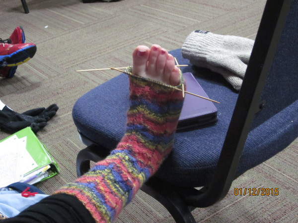 "Ellie Magner knits a sock, a popular pastime here at Holden.<a href=""/reason/images/597601_orig.jpg"" title=""High res"">∝</a>"