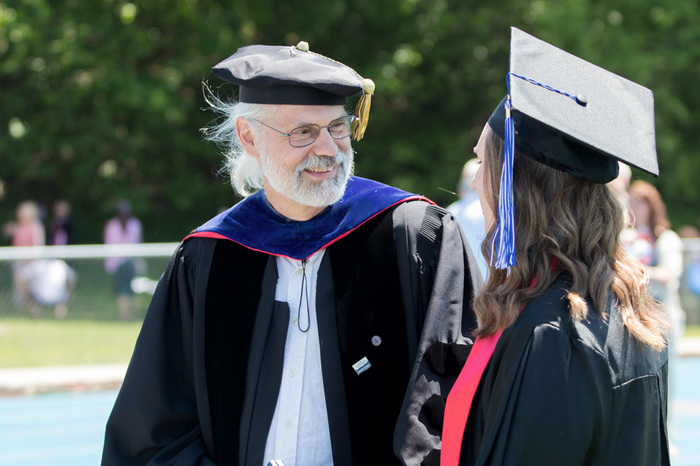 Professor Storm Bailey speaking with Emily Holm '16 at Commencement