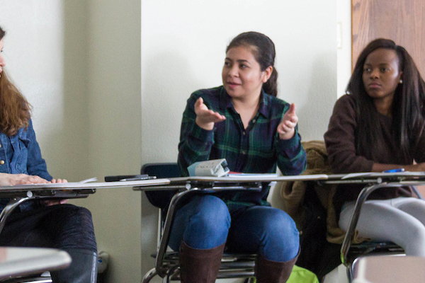 Students participate in a discussion during class.
