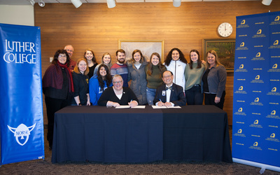 President Ward and President Wee surrounded by social work students and faculty